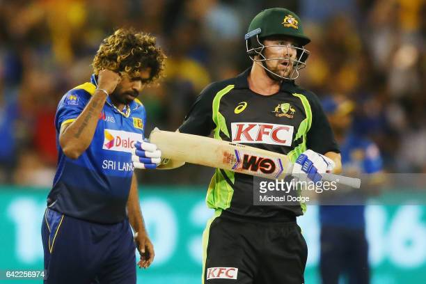 Lasith Malinga of Sri Lanka celebrates the wicket of Travis Head of Australia during the first International Twenty20 match between Australia and Sri...