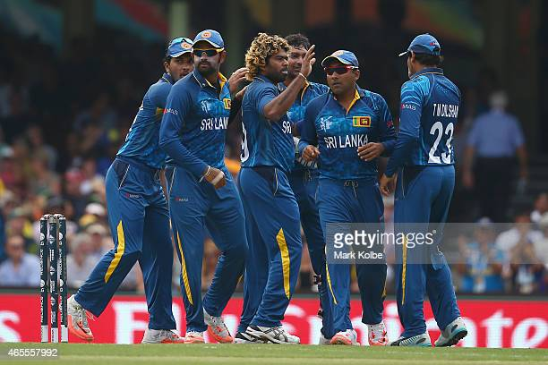 Lasith Malinga of Sri Lanka celebrates with his team mates after taking the wicket of David Warner of Australia during the 2015 ICC Cricket World Cup...