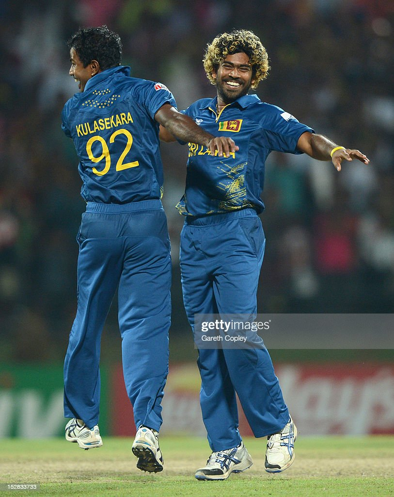 <a gi-track='captionPersonalityLinkClicked' href=/galleries/search?phrase=Lasith+Malinga&family=editorial&specificpeople=171602 ng-click='$event.stopPropagation()'>Lasith Malinga</a> of Sri Lanka celebrates with <a gi-track='captionPersonalityLinkClicked' href=/galleries/search?phrase=Nuwan+Kulasekara&family=editorial&specificpeople=608308 ng-click='$event.stopPropagation()'>Nuwan Kulasekara</a> after winning the super over and beating New Zealand during the ICC World Twenty20 2012 Super Eights Group 1 match at Pallekele Cricket Stadium on September 27, 2012 in Kandy, Sri Lanka.