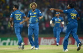 Lasith Malinga of Sri Lanka celebrates with Nuwan Kulasekara and Mahela Jayawardene after winning the super over and beating New Zealand during the...