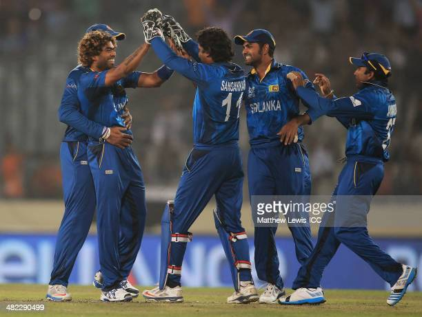 Lasith Malinga of Sri Lanka is congratulated by team mates after bowling Chris Gayle of the West Indies during the ICC World Twenty20 Bangladesh 2014...