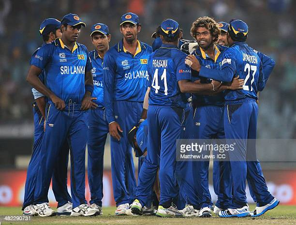 Lasith Malinga of Sri Lanka is congratulated by team mates after bowling Dwayne Smiith of the West Indies during the ICC World Twenty20 Bangladesh...
