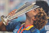 Lasith Malinga of Sri Lanka kisses the trophy after winning the Final of the ICC World Twenty20 Bangladesh 2014 between India and Sri Lanka at...