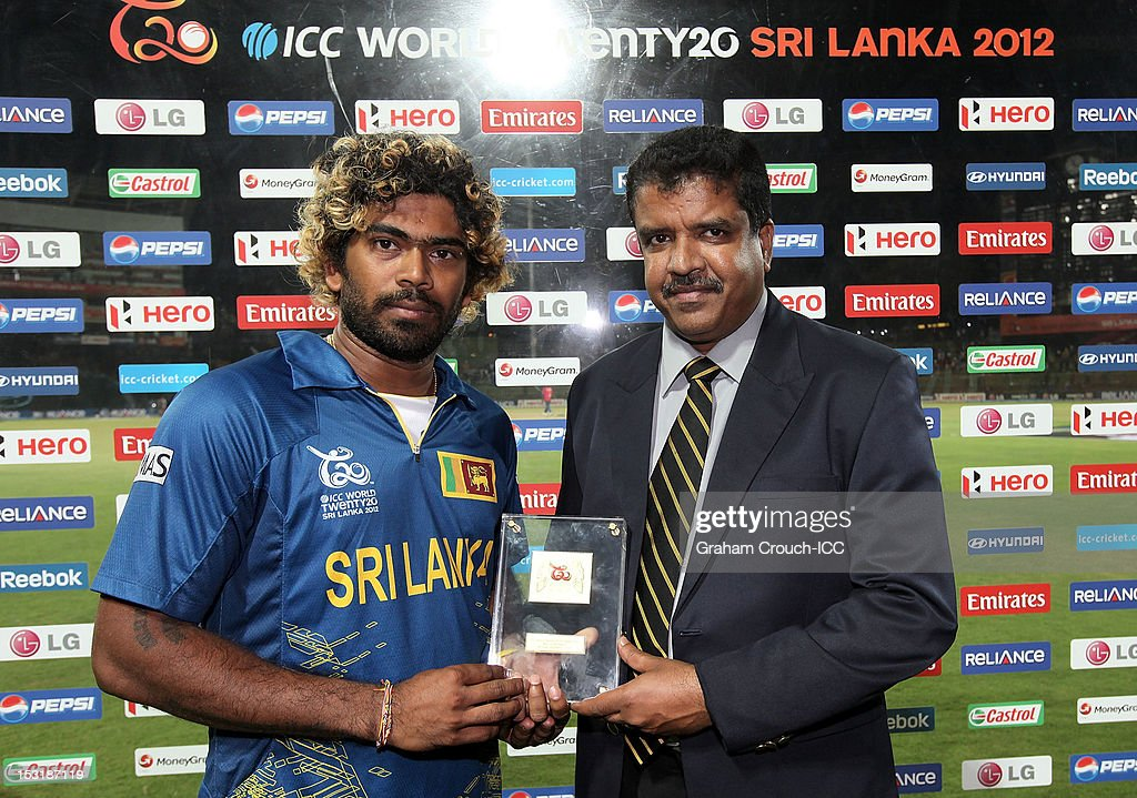 <a gi-track='captionPersonalityLinkClicked' href=/galleries/search?phrase=Lasith+Malinga&family=editorial&specificpeople=171602 ng-click='$event.stopPropagation()'>Lasith Malinga</a> of Sri Lanka, Man of the match for the Super Eights Group 1 match between England and Sri Lanka at Pallekele Cricket Stadium on October 1, 2012 in Kandy, Sri Lanka.