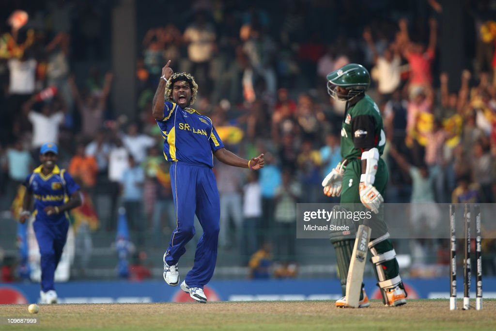<a gi-track='captionPersonalityLinkClicked' href=/galleries/search?phrase=Lasith+Malinga&family=editorial&specificpeople=171602 ng-click='$event.stopPropagation()'>Lasith Malinga</a> (C) of Sri Lankla celebrates bowling Shem Ngoche during the Kenya v Sri Lanka 2011 ICC World Cup Group A match at the R. Premadasa Stadium on March 1, 2011 in Colombo, Sri Lanka.
