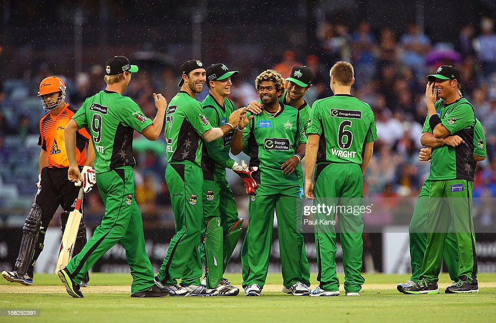 Lasith Malinga of the Stars is congratulated by team mates after dismissing Joe Mennie of the Scorchers during the Big Bash League match between the Perth Scorchers and the Melbourne Stars at WACA on December 12, 2012 in Perth, Australia.