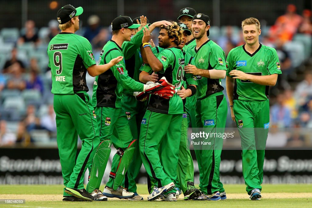 Lasith Malinga of the Stars is congratulated by team mates after dismissing Hilton Cartwright of the Scorchers during the Big Bash League match between the Perth Scorchers and the Melbourne Stars at WACA on December 12, 2012 in Perth, Australia.