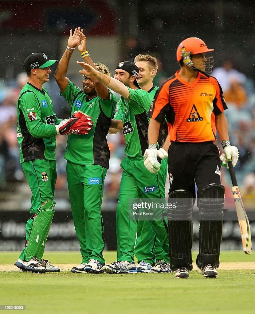 Lasith Malinga of the Stars is congratulated by team mates after dismissing Nathan Coulter-Nile of the Scorchers during the Big Bash League match between the Perth Scorchers and the Melbourne Stars at WACA on December 12, 2012 in Perth, Australia.