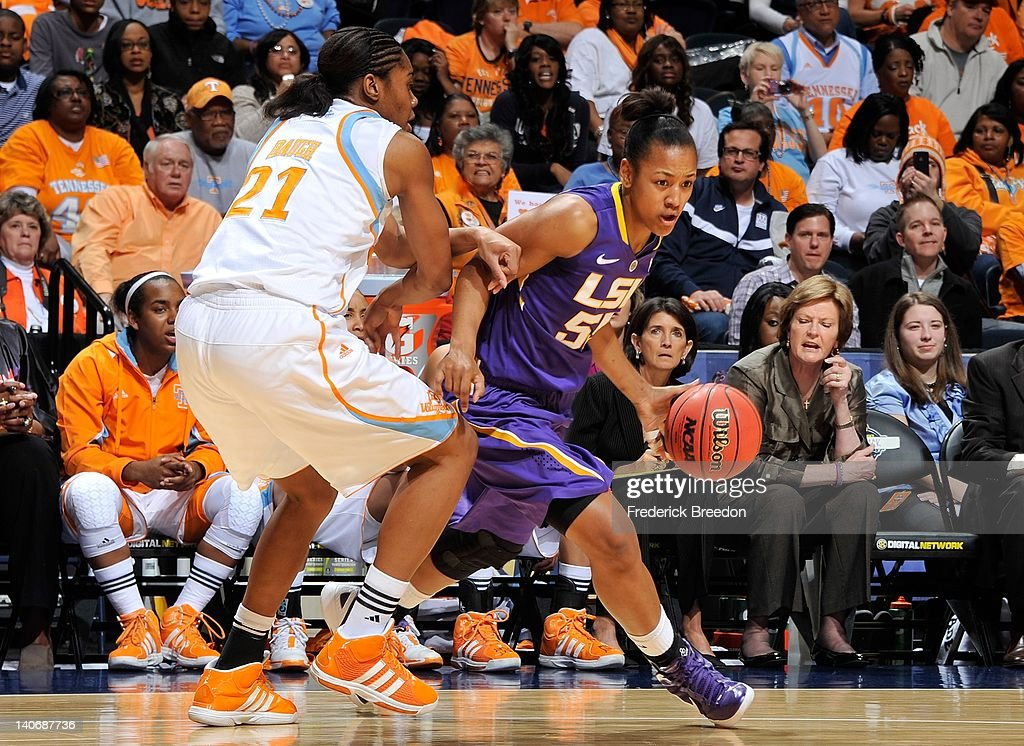 LaSondra Barrett #55 of the LSU Tigers drives past Vicki Baugh#21 of the Tennessee Volunteers during the SEC Women's Basketball Tournament Championship game at the Bridgestone Arena on March 4, 2012 in Nashville, Tennessee.