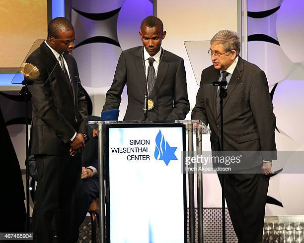 Lassana Bathily accepts the Simon Wiesenthal Center Medal of Valor onstage at the Simon Wiesenthal Center 2015 National Tribute Dinner at The Beverly...