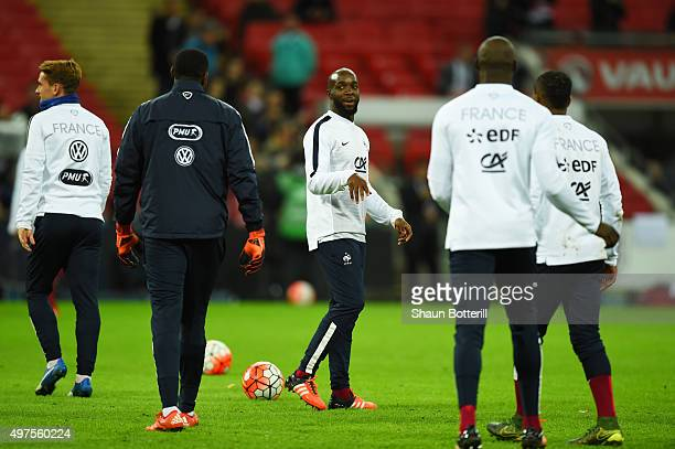 Lassana Diarra and Franch players warm up prior to the International Friendly match between England and France at Wembley Stadium on November 17 2015...