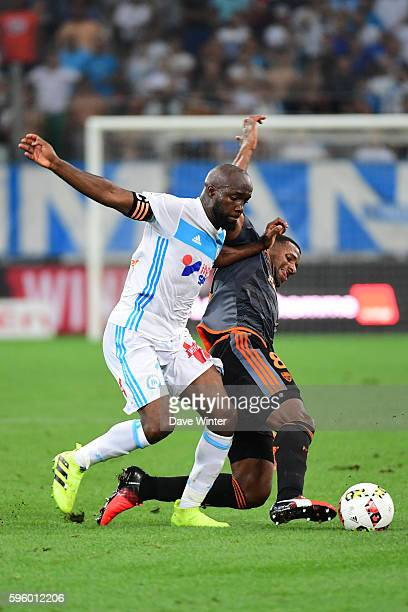 Lassana Diarra of Marseille and Carlos Miguel Cafu of Lorient during the French Ligue 1 match between Marseille and Lorient at Stade Velodrome on...