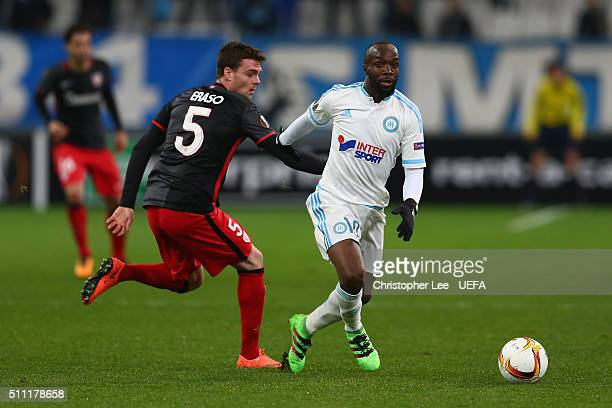 Lassana Diarra of Marseille and Javier Eraso of Athletic Club Bilbao compete for the ball during the UEFA Europa League Round of 32 match between...