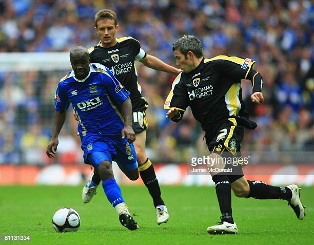 Lassana Diarra of Portsmouth takes on Stephen McPhail and Kevin McNaughton of Cardiff City during the FA Cup Final sponsored by EON between...