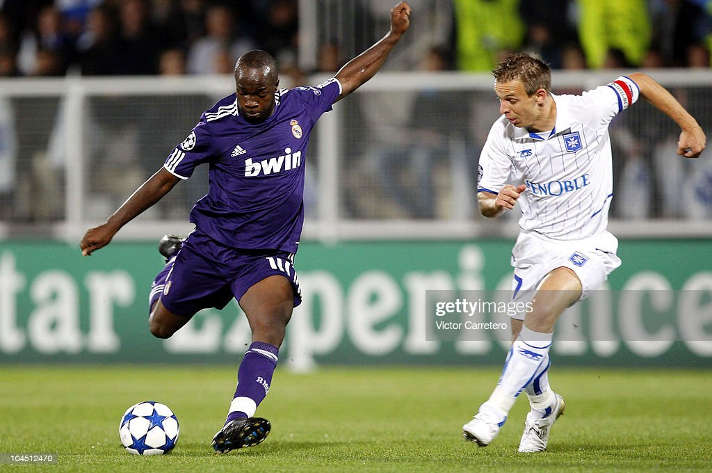 <a gi-track='captionPersonalityLinkClicked' href=/galleries/search?phrase=Lassana+Diarra&family=editorial&specificpeople=607251 ng-click='$event.stopPropagation()'>Lassana Diarra</a> (L) of Real Madrid shoots on goal in front of <a gi-track='captionPersonalityLinkClicked' href=/galleries/search?phrase=Benoit+Pedretti&family=editorial&specificpeople=714997 ng-click='$event.stopPropagation()'>Benoit Pedretti</a> of Auxerre during the UEFA Champions League group G match between Auxerre and Real Madrid at Abbe-Deschamps stadium on September 28, 2010 in Auxerre, France.