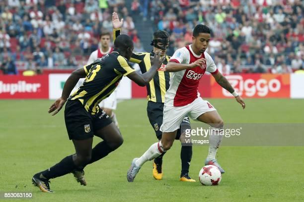 Lassana Faye of Vitesse Bryan Linssen of Vitesse Justin Kluivert of Ajax during the Dutch Eredivisie match between Ajax Amsterdam and Vitesse Arnhem...