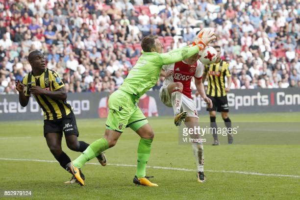 Lassana Faye of Vitesse goalkeeper Remko Pasveer of Vitesse Frenkie de Jong of Ajax during the Dutch Eredivisie match between Ajax Amsterdam and...