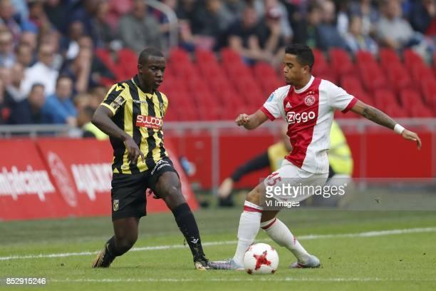 Lassana Faye of Vitesse Justin Kluivert of Ajax during the Dutch Eredivisie match between Ajax Amsterdam and Vitesse Arnhem at the Amsterdam Arena on...