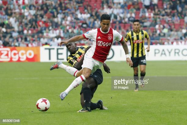 Lassana Faye of Vitesse Justin Kluivert of Ajax during the Dutch Eredivisie match between Ajax Amsterdam and Vitesse Arnhem at the Amsterdam Arena on...
