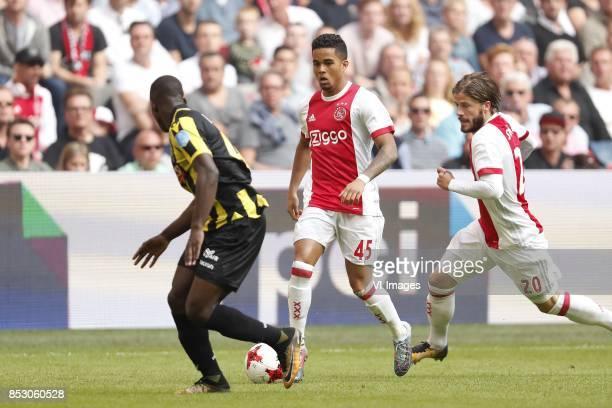 Lassana Faye of Vitesse Justin Kluivert of Ajax Lasse Schone of Ajax during the Dutch Eredivisie match between Ajax Amsterdam and Vitesse Arnhem at...