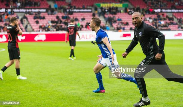 Lasse Fosgaard of Lyngby Boldklub and David Nielsen head coach of Lyngby Boldklub celebrates their victory after the Danish Alka Superliga match...