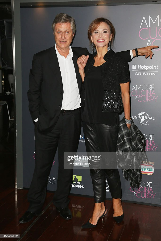 Lasse Hallstrom and Lena Olin attend the 'The HundredFoot Journey' photocall at Hotel Radisson Blu on October 1 2014 in Rome Italy