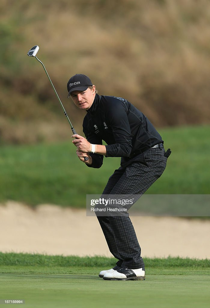 Lasse Jensen of Denamrk reacts to missing a birdie putt on the 18th green during the final round of the European Tour Qualifying School Finals at PGA Catalunya Resort on November 29, 2012 in Girona, Spain.