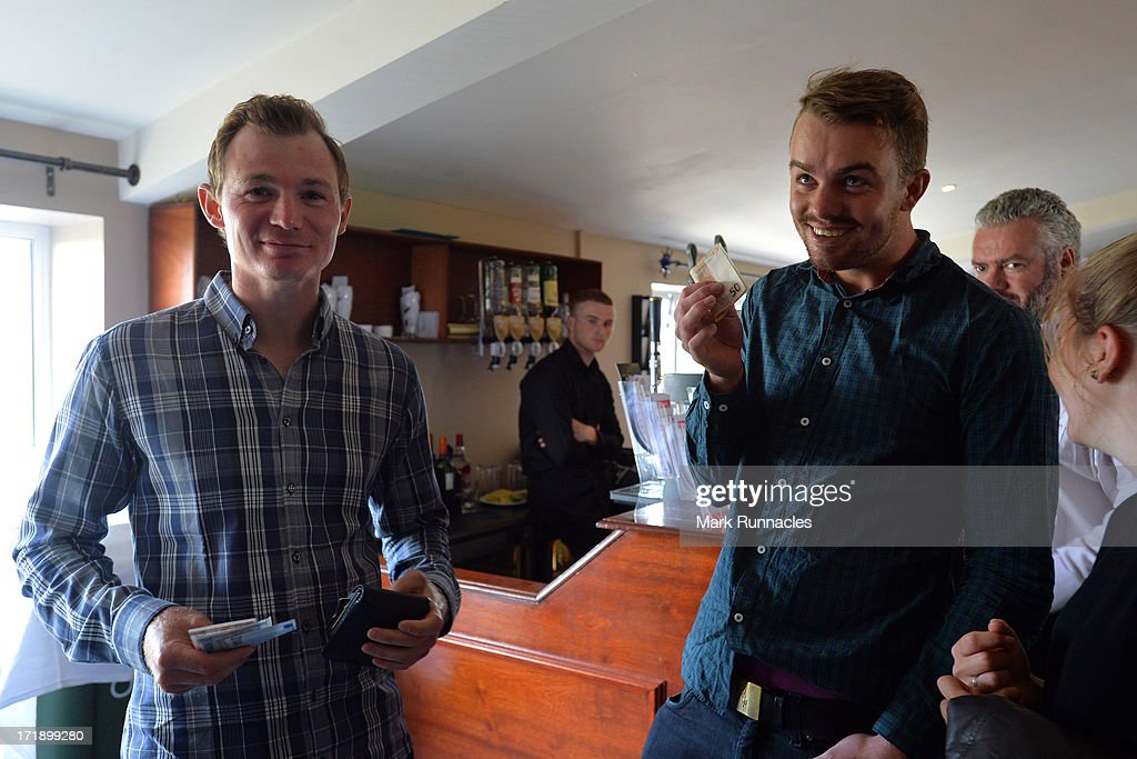 Lasse Jensen of Denmark (L) and Andreas Harto of Denmark attend The Dubai Duty Free Irish Derby after the Third Round of the Irish Open at Carton House Golf Club on June 29, 2013 in Maynooth, Ireland.