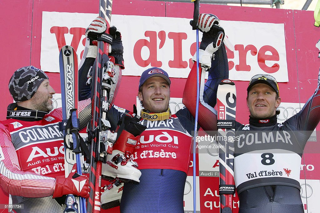 (L-R) Lasse Kjuss (2nd) Bode Miller (1st) and Herman Maier celebrate on the podium after winning the FIS Ski World Cup 2005 Mens Super Giant Slalom Slalom event on December 12, 2004 in Val D'Isere, France.