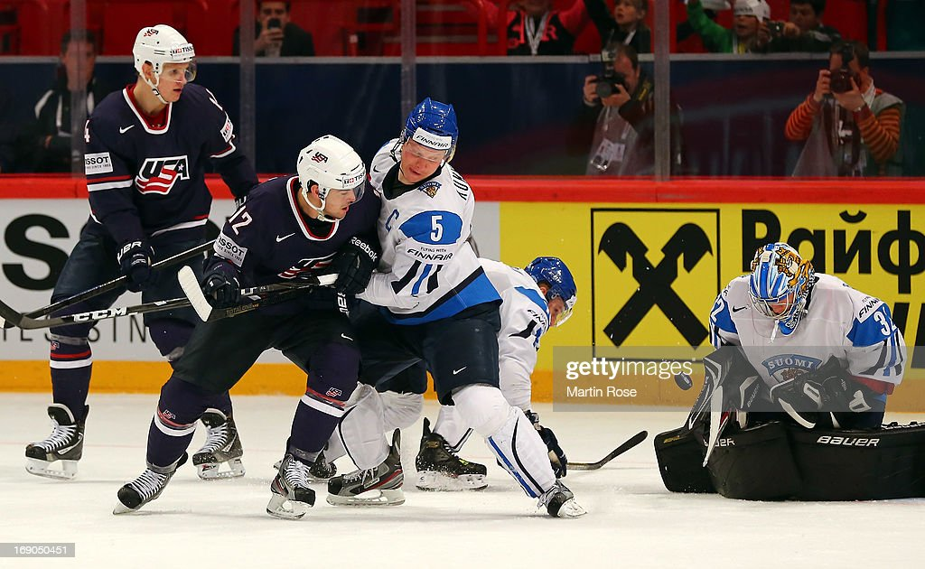 Lasse Kukkonen of Finland and Bobby Butler of USA battle for the puck during the IIHF World Championship third place match between Finland and USA at...