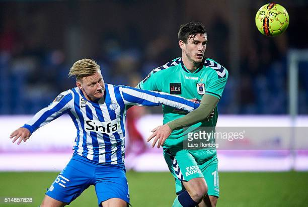 Lasse Rise of Esbjerg fB and Josip Elez of AGF Aarhus compete for the ball during the Danish Alka Superliga match between Esbjerg and AGF Aarhus at...