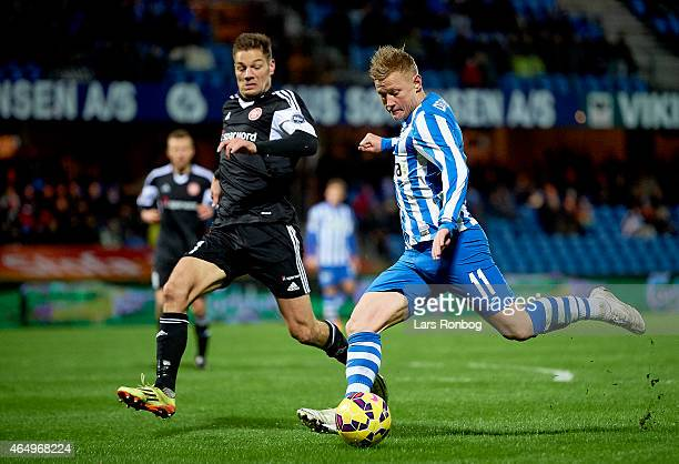 Lasse Rise of Esbjerg FB and Kasper Risgard of AaB Aalborg compete for the ball during the Danish Alka Superliga match between Esbjerg fb and AaB...