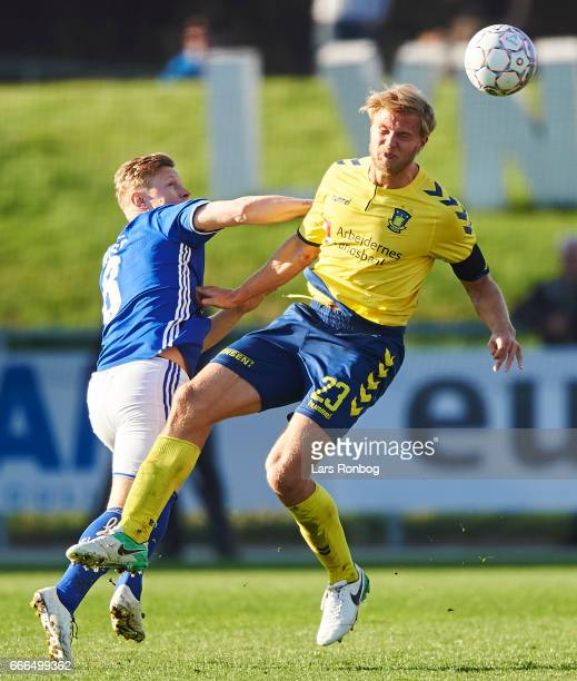 Lasse Rise of Lyngby BKn and Paulus Arajuuri of Brondby IF compete for the ball during the Danish Alka Superliga match between Lyngby BK and Brondby...