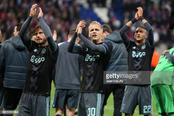 Lasse Schoene Donny van de Beek Hakim Ziyech of Ajax Amsterdam celebrate the qualification for the Final following the UEFA Europa League semi final...