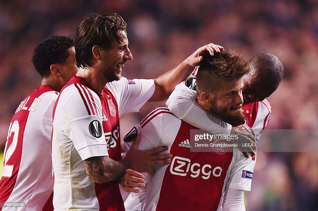 Lasse Schoene of AFC Ajax celebrates with team mates as he scores the equalizing goal during the UEFA Europa League Group A match between AFC Ajax and Celtic FC at Amsterdam Arena on September 17, 2015 in Amsterdam, Netherlands.