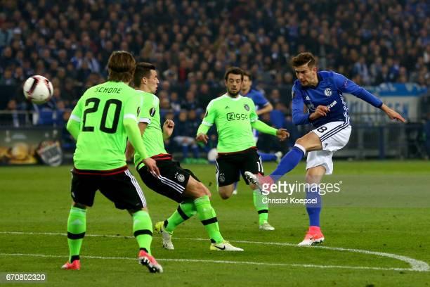 Lasse Schoene of Amsterdam blocks a shot of Leon Goretzka of Schalke during the UEFA Europa League quarter final second leg match between FC Schalke...