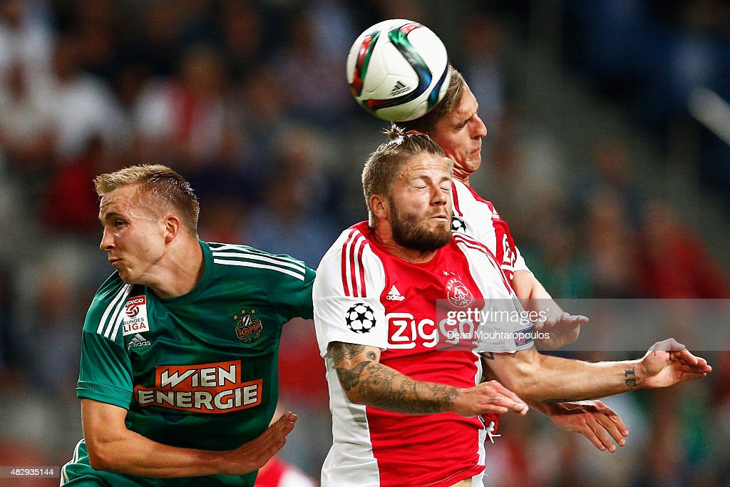 Lasse Schone (C) and Arkadiusz Milik of Ajax challenges for the headed ball with Christopher Dibon of Rapid Wien during the third qualifying round 2nd leg UEFA Champions League match between Ajax Amsterdam and SK Rapid Vienna held at Amsterdam ArenA on August 4, 2015 in Amsterdam, Netherlands.