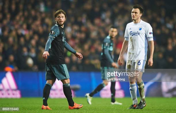 Lasse Schone of Ajax Amsterdam and William Kvist of FC Copenhagen looks on during the UEFA Europa League Round of 16 First Leg match between FC...