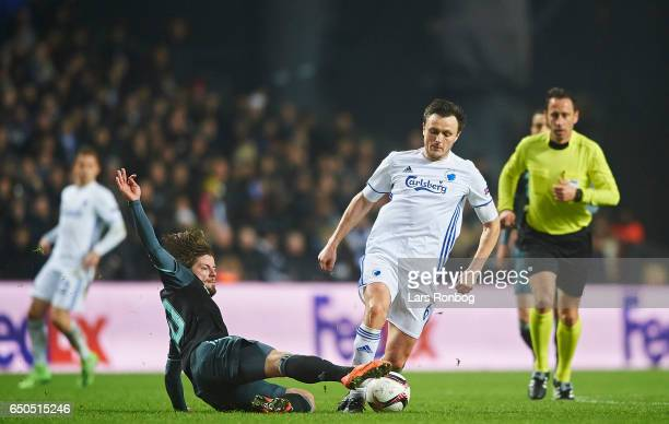 Lasse Schone of Ajax Amsterdam and William Kvist of FC Copenhagen compete for the ball during the UEFA Europa League Round of 16 First Leg match...