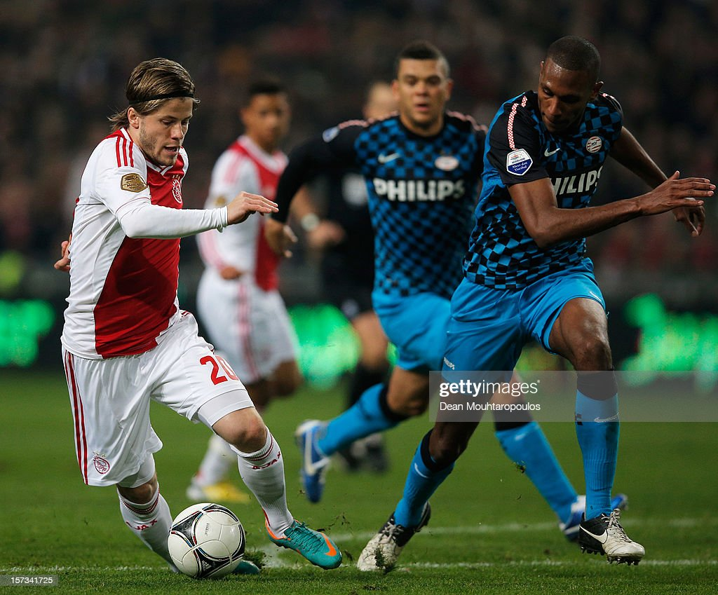 Lasse Schone of Ajax attempts to get past Marcelo Antonio Guedes Filho of PSV during the Eredivisie match between Ajax Amsterdam and PSV Eindhoven at Amsterdam Arena on December 1, 2012 in Amsterdam, Netherlands.