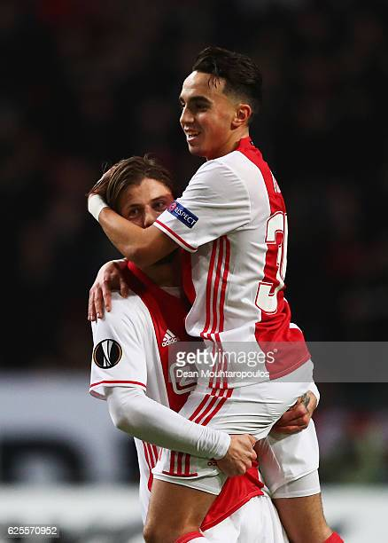 Lasse Schone of Ajax celebrates with Abdelhak Nouri as he scores their first goal during the UEFA Europa League Group G match between AFC Ajax and...