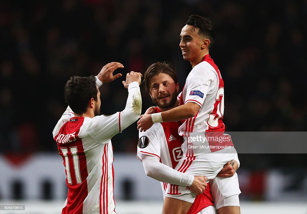 Lasse Schone of Ajax (C) celebrates with Amin Younes (L) and Abdelhak Nouri (R) as he scores their first goal during the UEFA Europa League Group G match between AFC Ajax and Panathinaikos FC at Amsterdam Arena on November 24, 2016 in Amsterdam, Netherlands.