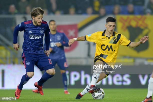 Lasse Schone of Ajax Giovanni Korte of NAC Breda during the Dutch Eredivisie match between NAC Breda v Ajax at the Rat Verlegh Stadium on November 18...