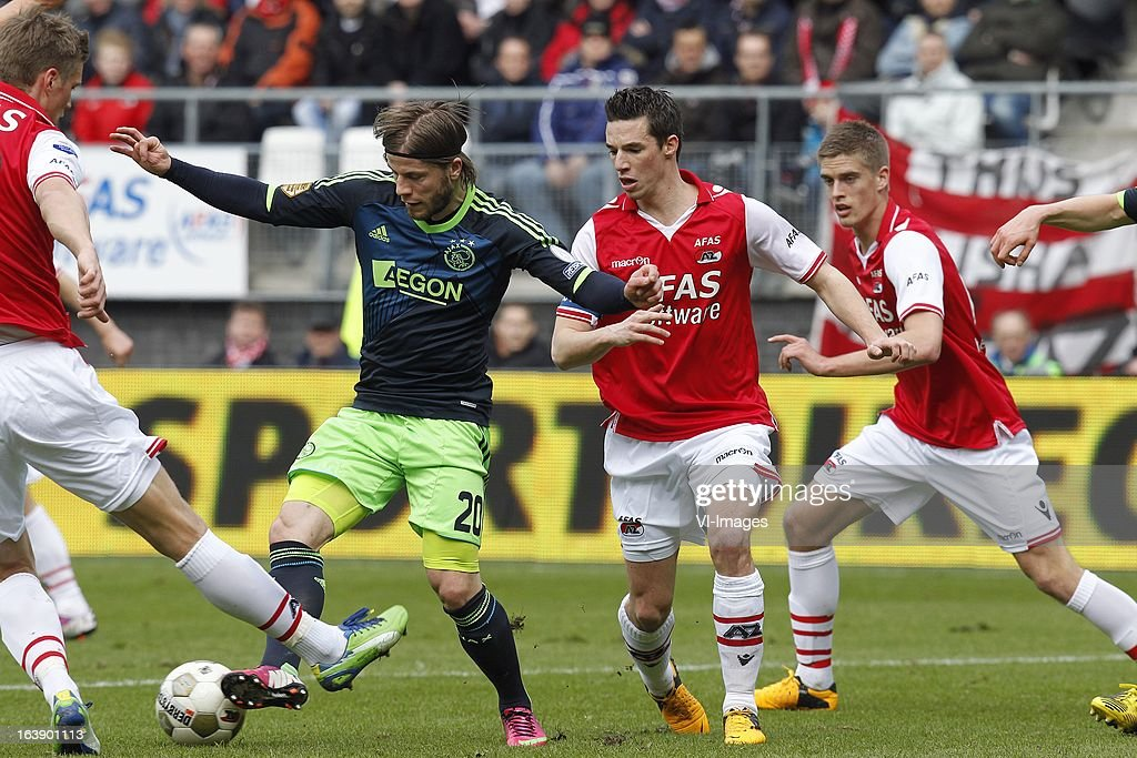 Lasse Schone of Ajax (CL), Nick Viergever of AZ (CR) during the Dutch Eredivisie match between AZ Alkmaar and Ajax Amsterdam at the AFAS Stadium on march 17, 2013 in Alkmaar, The Netherlands