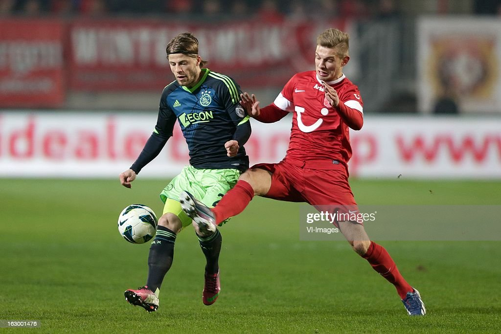 Lasse Schone of Ajax (L) Rasmus Bengtsson of FC Twente (R) during the Dutch Eredivisie match between FC Twente and Ajax Amsterdam at the Grolsch Veste on march 02, 2013 in Enschede, The Netherlands