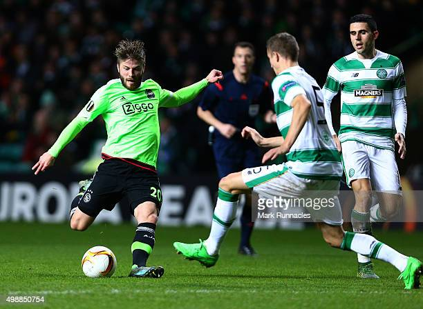 Lasse Schone of Ajaxhas his shot on goal charged down by Jozo Simunovic of Celtic during the UEFA Europa League Group A match between Celtic FC and...
