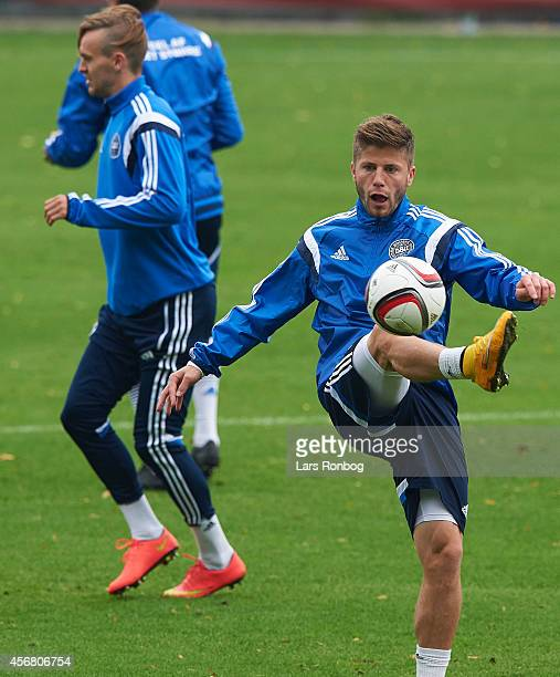 Lasse Schone of denmark controls the ball during the Denmark training session and press conference ahead of their UEFA EURO 2016 Group I qualifier...