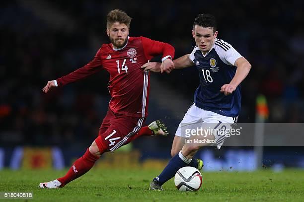 Lasse Schone of Denmark vies with John McGinn of Scotland during the International Friendly match between Scotland and Denmark at Hampden Park on...