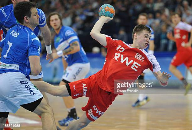 Lasse Seidel of Essen throws a goal during the DKB Bundesliga handball game between HSV Hamburg and TUSEM Essen at O2 World on April 17 2013 in...