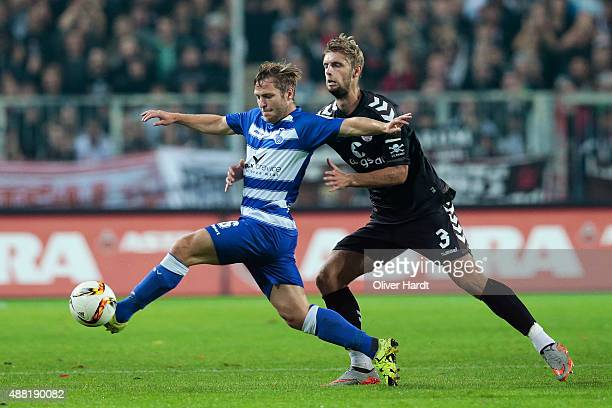 Lasse Sobiech of Pauli and Martin Dausch of Duisburg compete for the ball during the Second Bundesliga match between FC St Pauli and MSV Duisburg at...